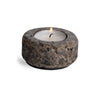 single granite tea light holder with lit candle