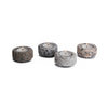 four granite tea light holders with lit candles