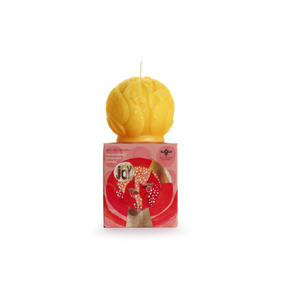 "cardinal sculpted candle on top of red ""joy"" packaging"
