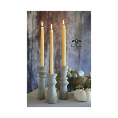 three natural colored 100% Pure Beeswax tapers in rustic stone holders, with autumn backdrop featuring green and white pumpkins