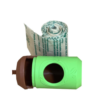 green pet waste bag container with brown lid. roll of waste bags outside of the container, rolled up in tight roll indicating how it fits in the dispenser.
