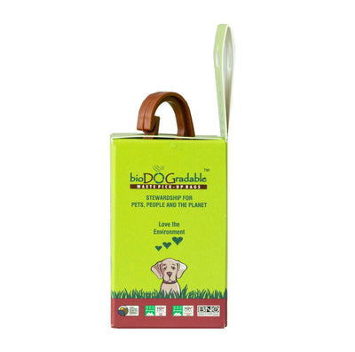 leash dispenser pack, green and cardboard with product poking through top of container.