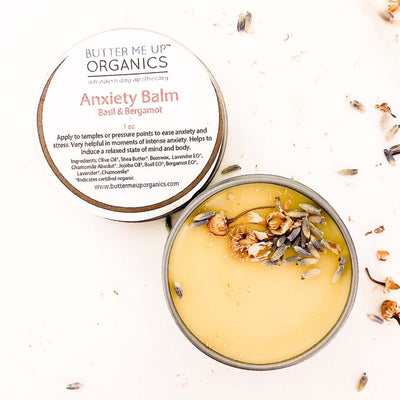 golden anxiety balm in container, 1 oz, lid ajar. contains raw lavender pieces
