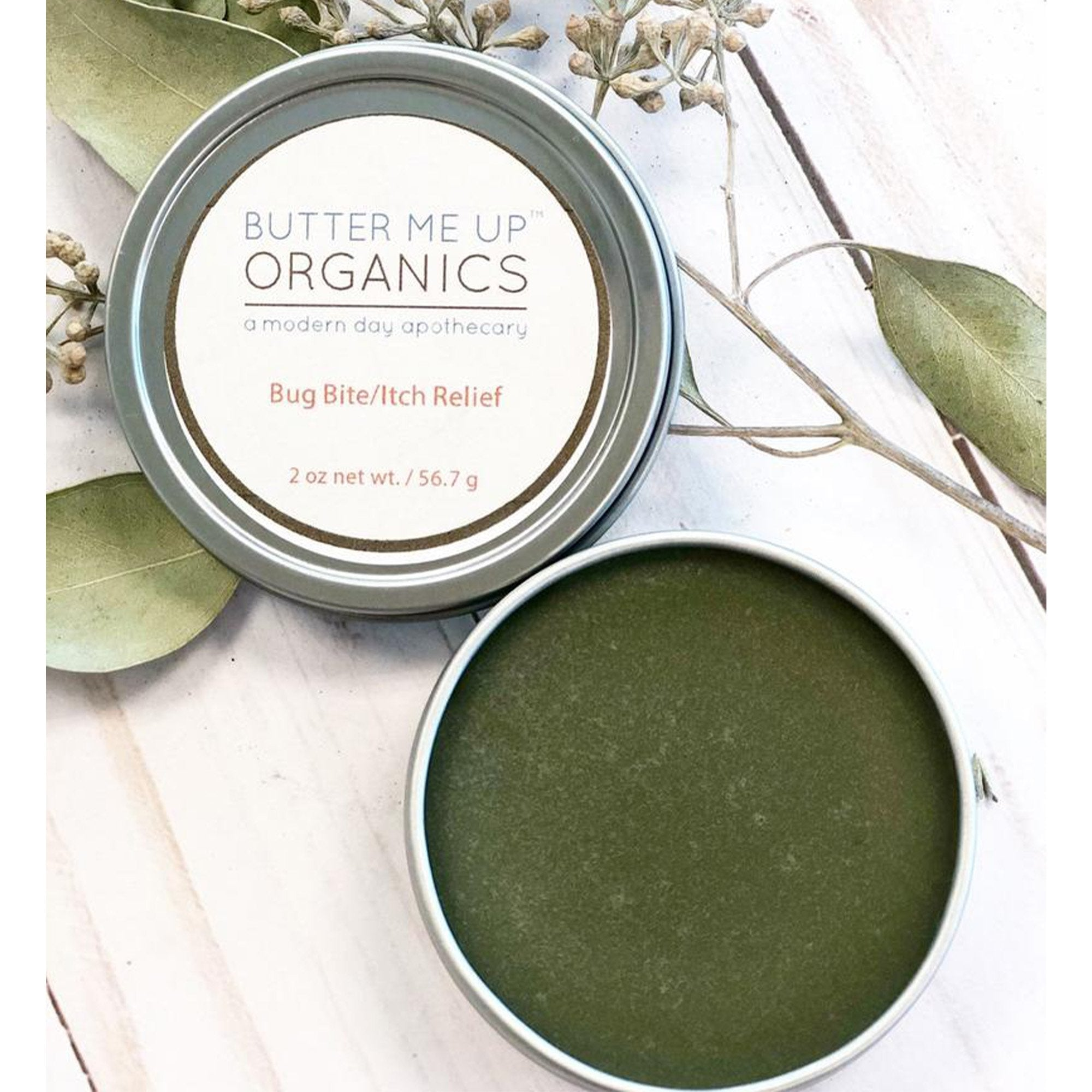 tin container and lid, green butter me up organics bug bite/itch relief, 2 oz, weight 56.7 g