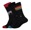 three black socks with different designs. red and black with grey map of world. orange speckled with blue toe, black with rainbow wrapped around shin portion