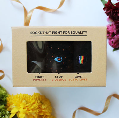 cardboard package with clear window displaying assorted socks that fight for equality