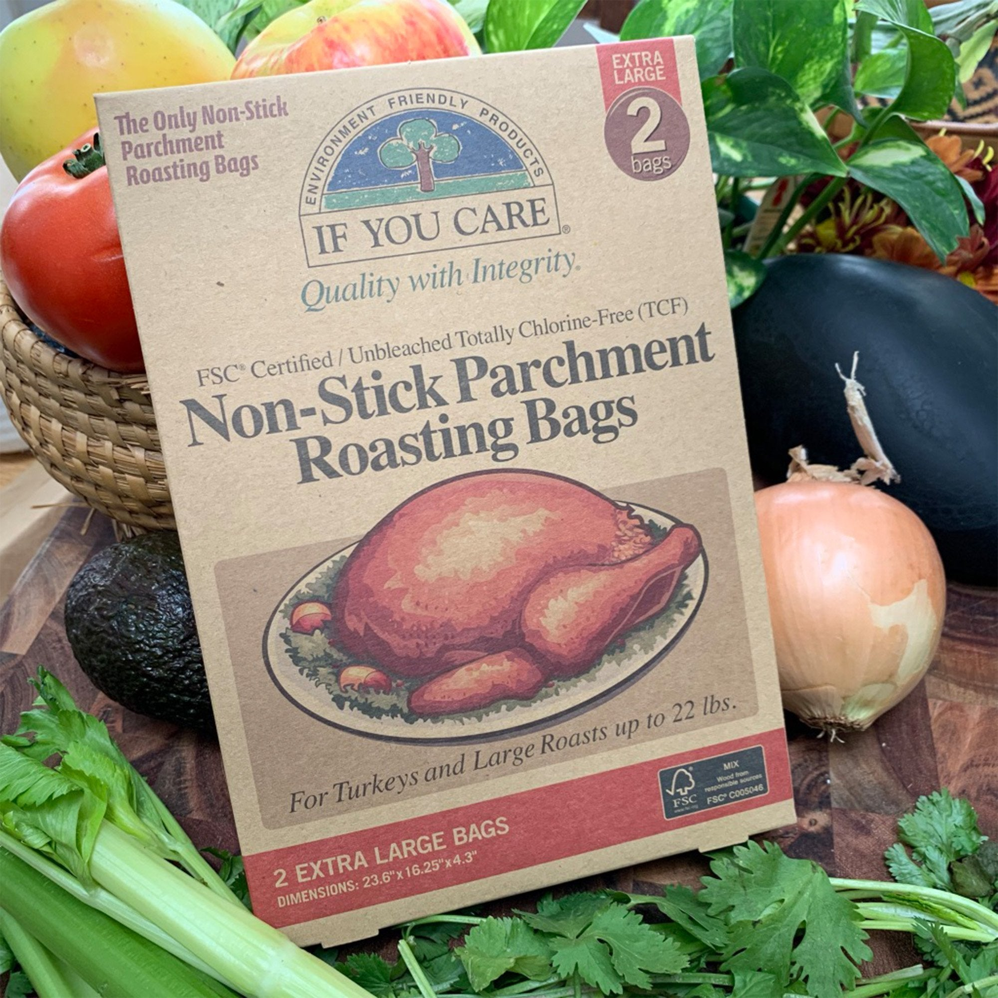 "non-stick parchment roasting bags in package. 2 extra large bags. bags are 23.6"" x 16.25"" x 4.3"" displayed on bed of vegetables"