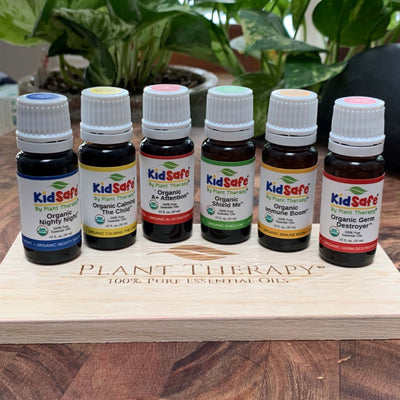 6, 10 mL essential oils in brown bottles with white lids on wood tabletop