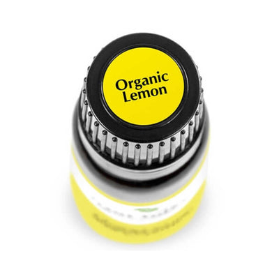 "birds eye view of black bottle with yellow label, reads ""organic lemon"". 10 ml"