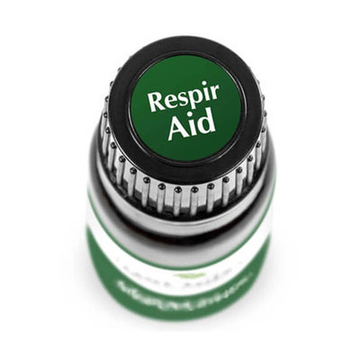 "birds eye view of brown bottle with green label. reads ""respir aid"""