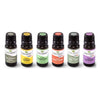 6, 10 ml black bottles of essential oil placed on white backdrop