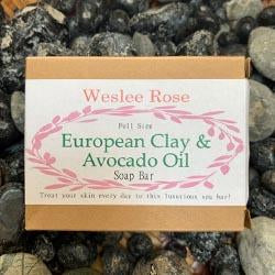 european clay & avacado oil soap bar cardboard package displayed on rocks