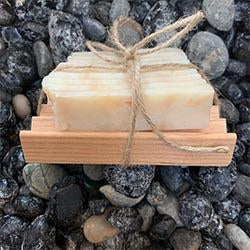 Eco friendly, all natural,  Great Outdoors soap bar full size. on wooden tray, wrapped in twine, displayed on rocks