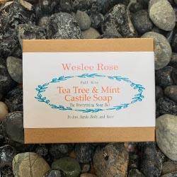 tea tree & mint castile soap full size soap bar pack, displayed on rocks