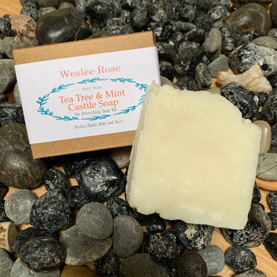 tea tree & mint castile soap full size soap bar, displayed on rocks