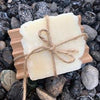 tea tree & mint castile soap full size soap bar, on wooden tray wrapped in twine, displayed on rocks