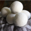 6 100% wool white dryer balls, one grey floral towel