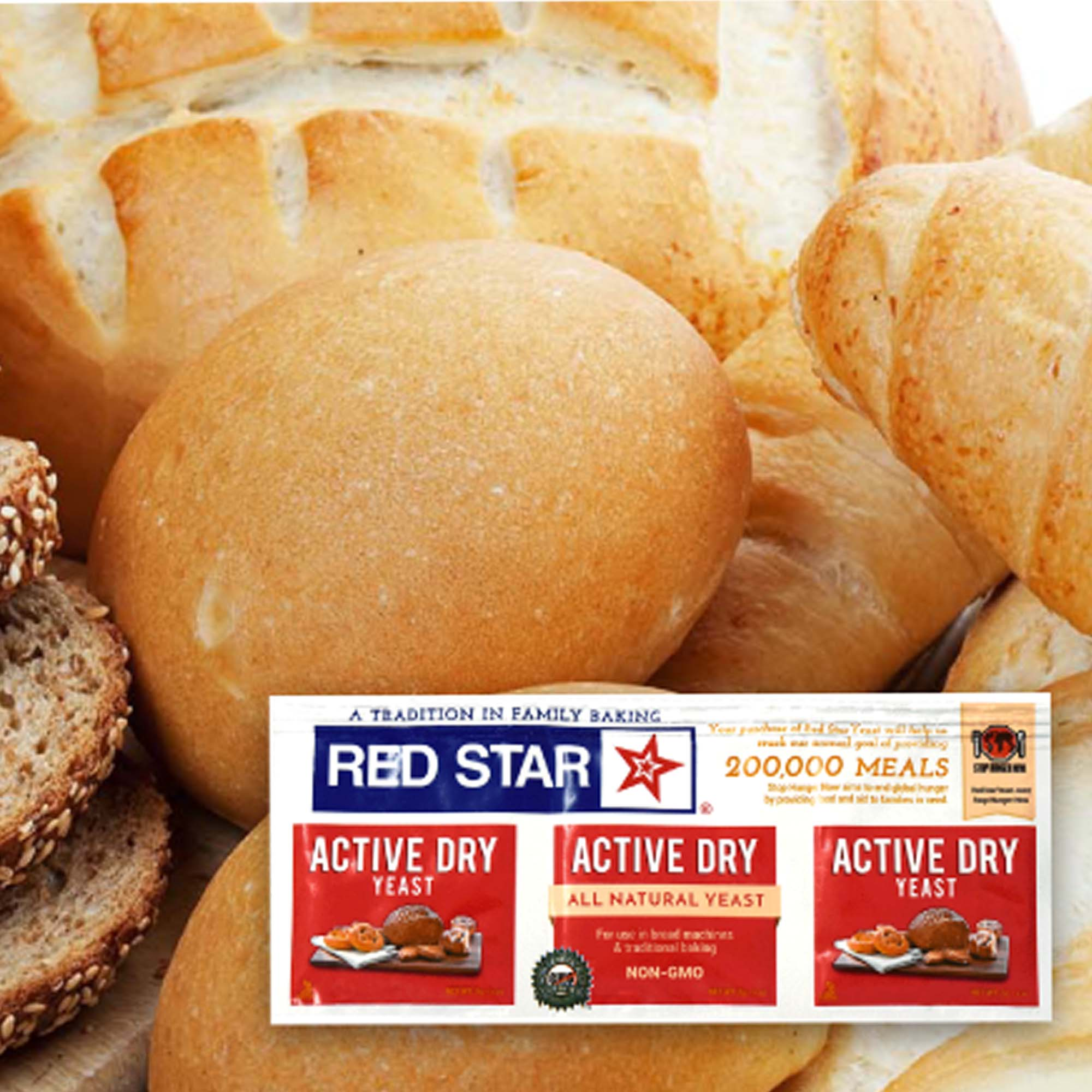 red white and blue packaging, red star logo woth information about active dry yeast. in the background are various types of breads and loaves