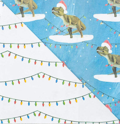 Close up of dinosaur (T-Rex wearing a Santa hat) paper and string holiday lights paper