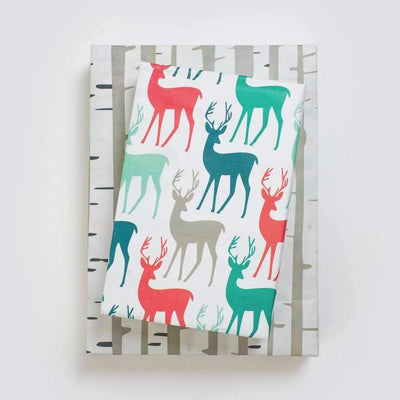 Two packages wrapped in stags/birch wrapping paper
