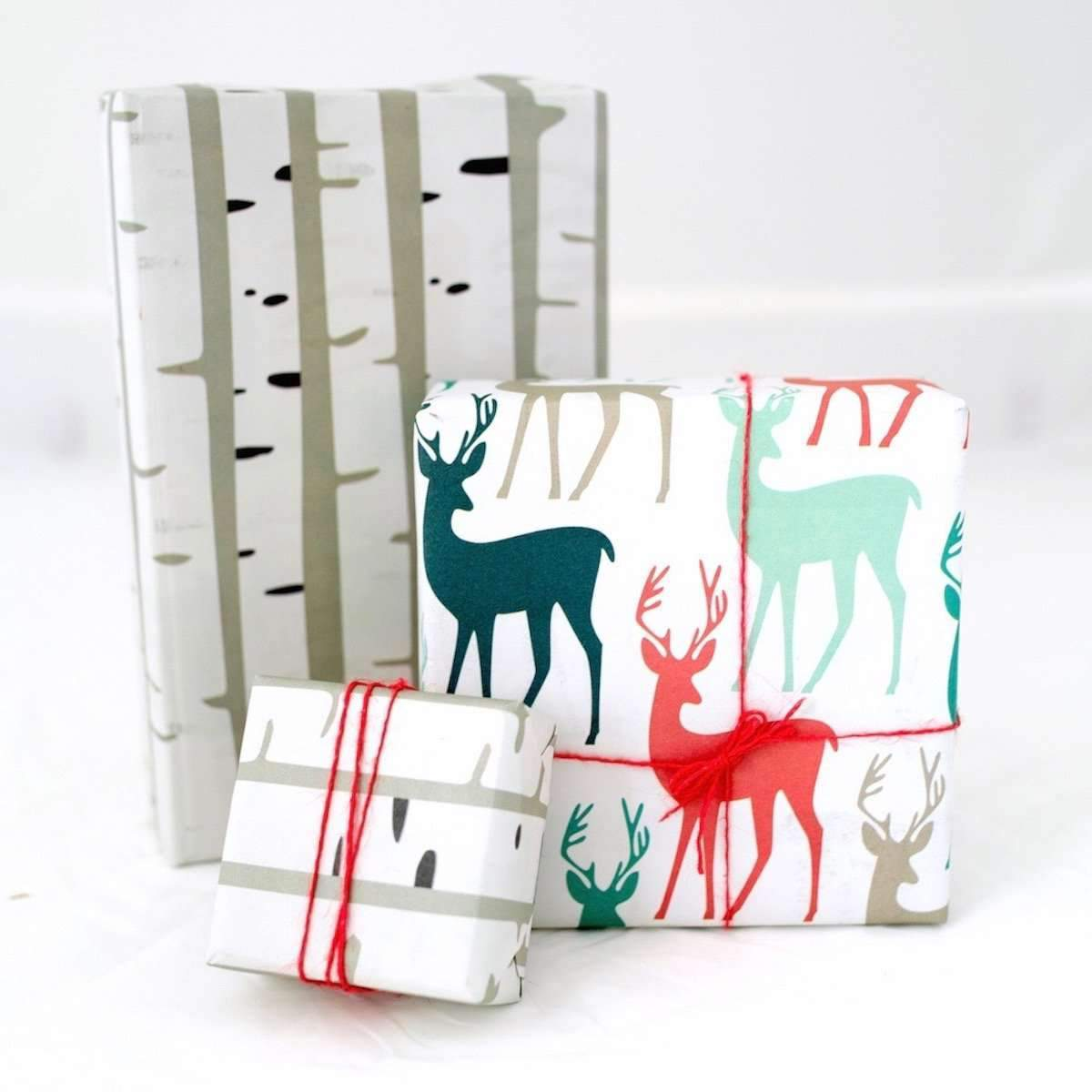 Three square/rectangle packages wrapped in stag & birch paper