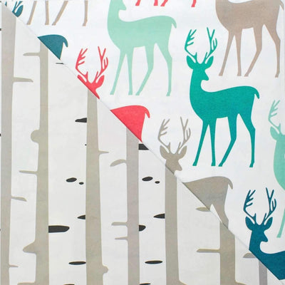 Close up  of stags (deer with antlers in muted red, green and light brown solid colors) and birch tree (light brown slim tree trunks) paper