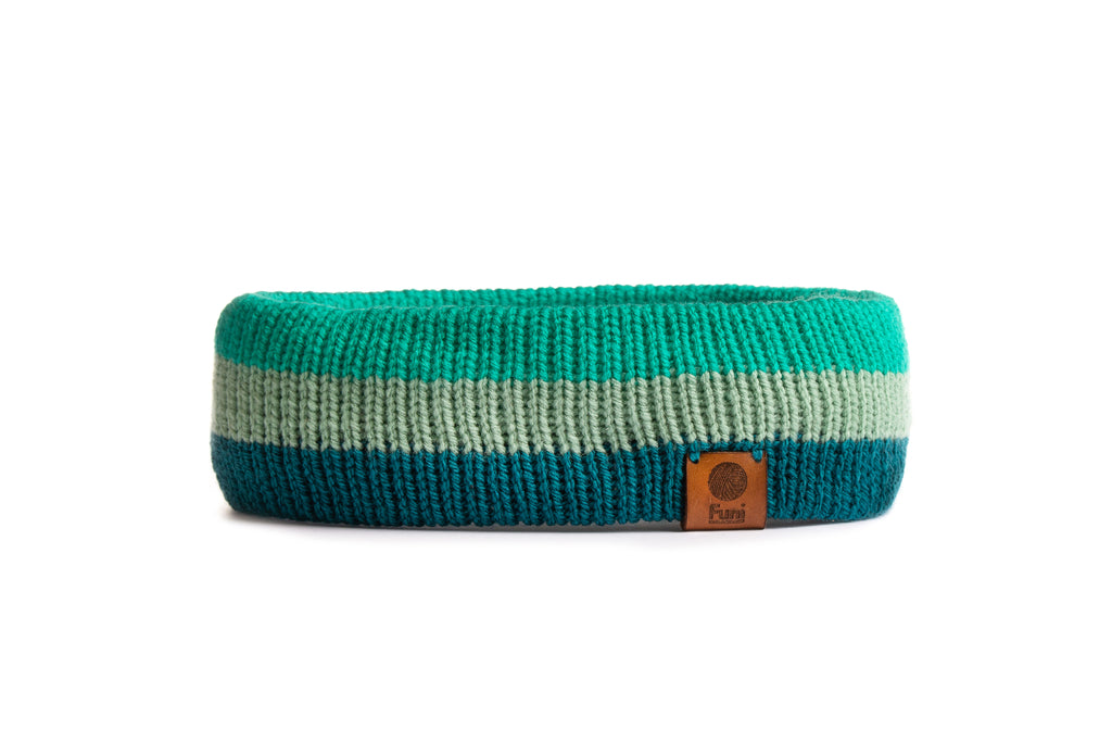 green handknitted headband with leather patch