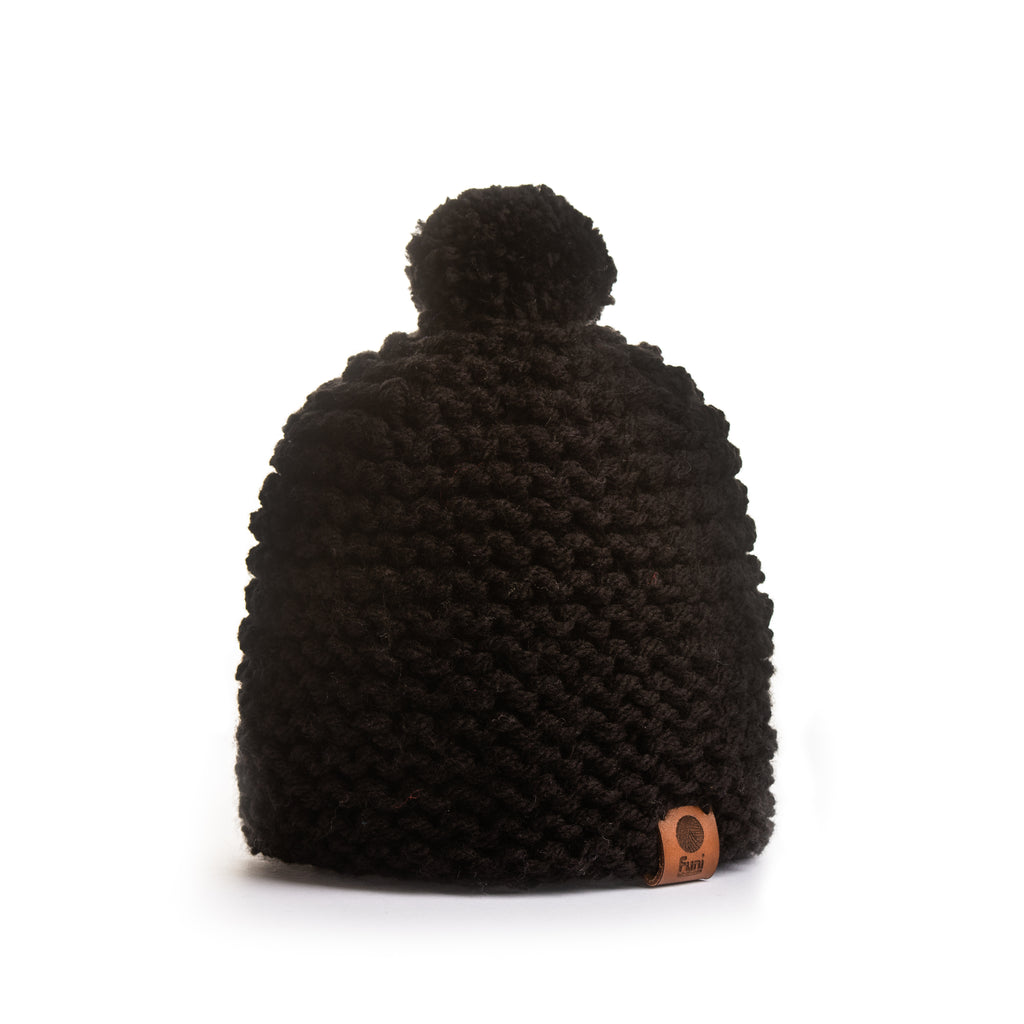 luxury black bobble hat with leather tag