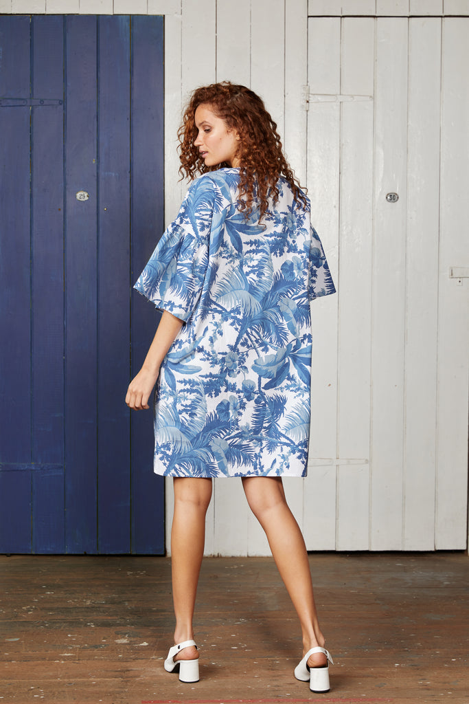 Binny West Indies Dress. Cotton, Oversized Shift Dress with Blue and White Tropical Print and Wide Ruffle Sleeve.
