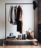 Clothing rack with distressed wood platforms