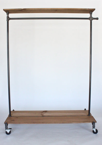 Industrial clothing rack with distressed wood platforms and top shelf