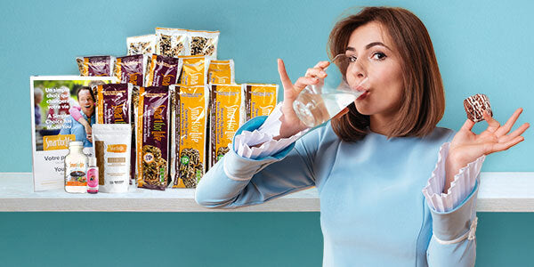 Woman drinking water and eating Smart for Life cookie
