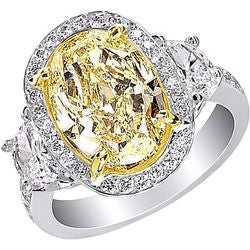 5.14 ct. Rare Natural Fancy Light Yellow Oval Diamond Ring in 18K White Gold - 1.10 ctw.