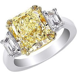 5.23 ct. Radiant Natural Fancy Yellow Diamond Platinum & 22kt Yellow Gold Ring with Trapezoid Accents - 0.81 ctw.