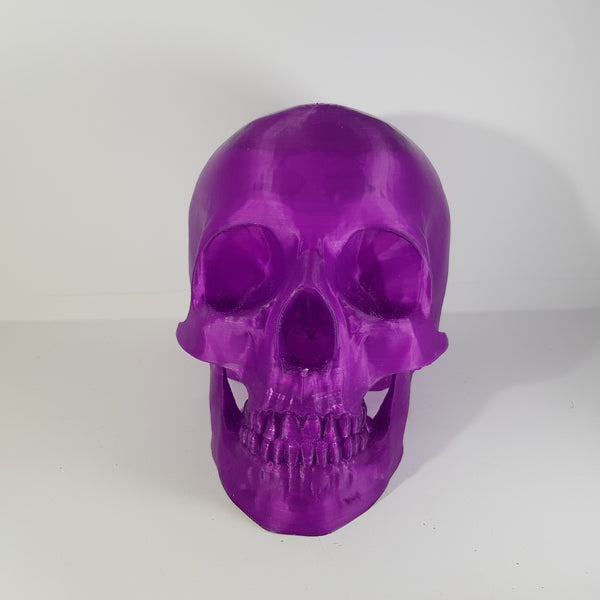 purple 3d printed skull by 3d printing revolution.