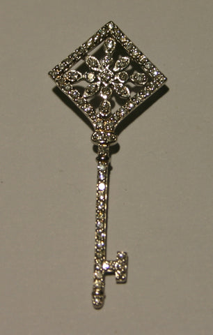 white gold and diamond key pendant