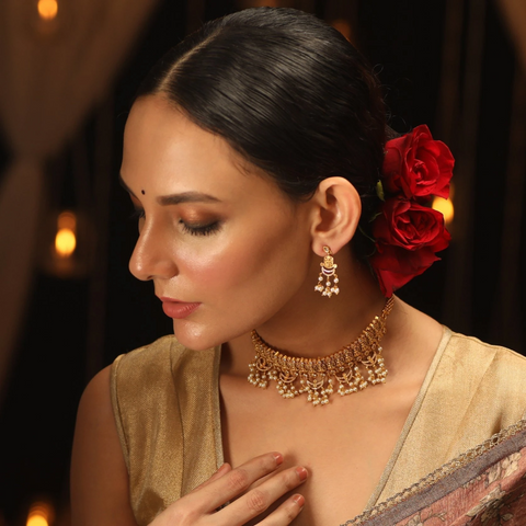 #3 Ravishing Royalty    One of the easiest ways to add a luxury element to your Indian look is by picking a statement choker necklace. And if you are someone who believes that less is more, our Dalia Antique Choker Necklace set will help you tie the look together. Translating the royalty, this lightweight piece is set with exquisite CZ stones and pearl detailing. We also have a unique collection of uniquely designed choker sets waiting for you.   https://www.tarinika.in/products/dalia-antique-choker-set