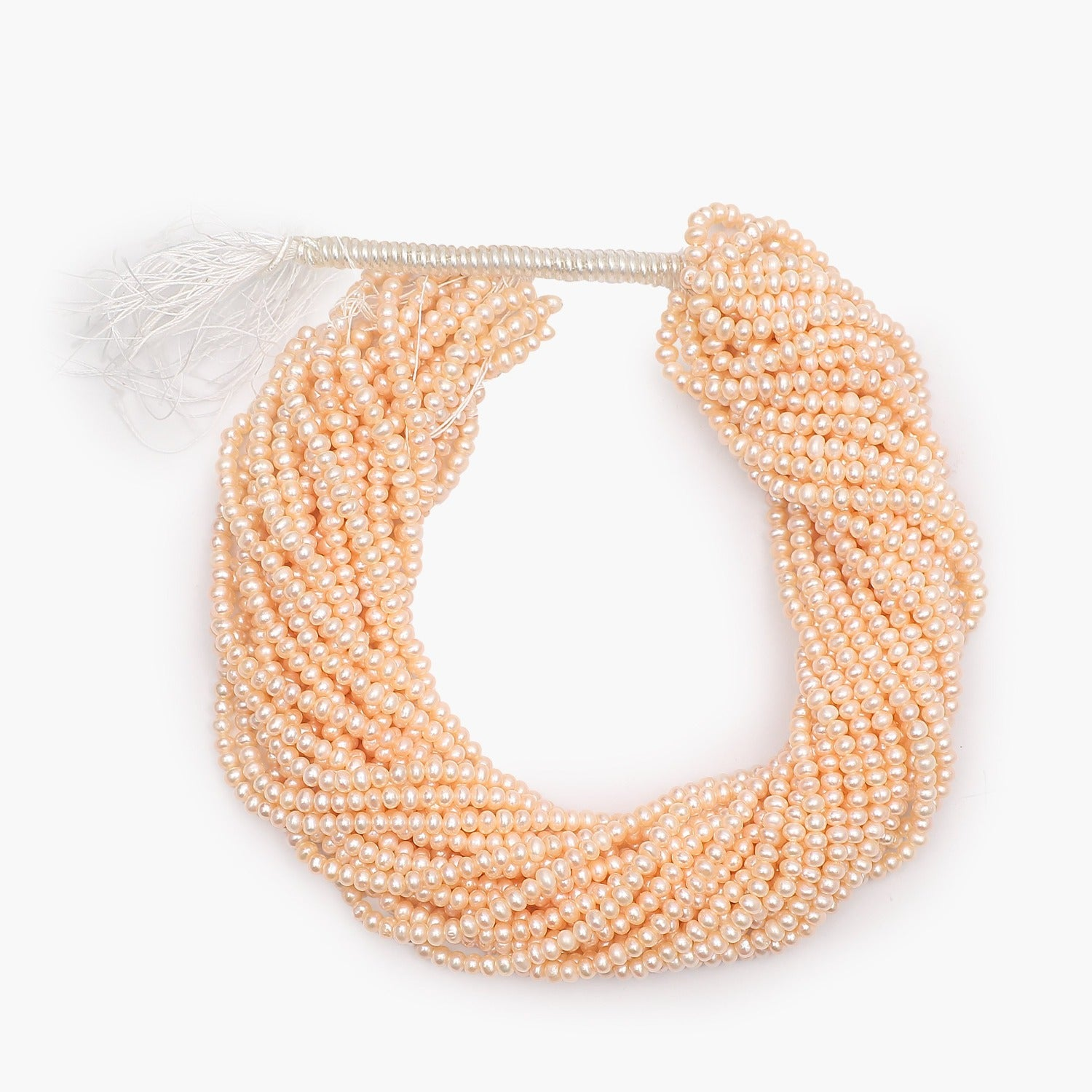 Freshwater Peach Button Pearls 4-4.5mm- Sold Per Strand