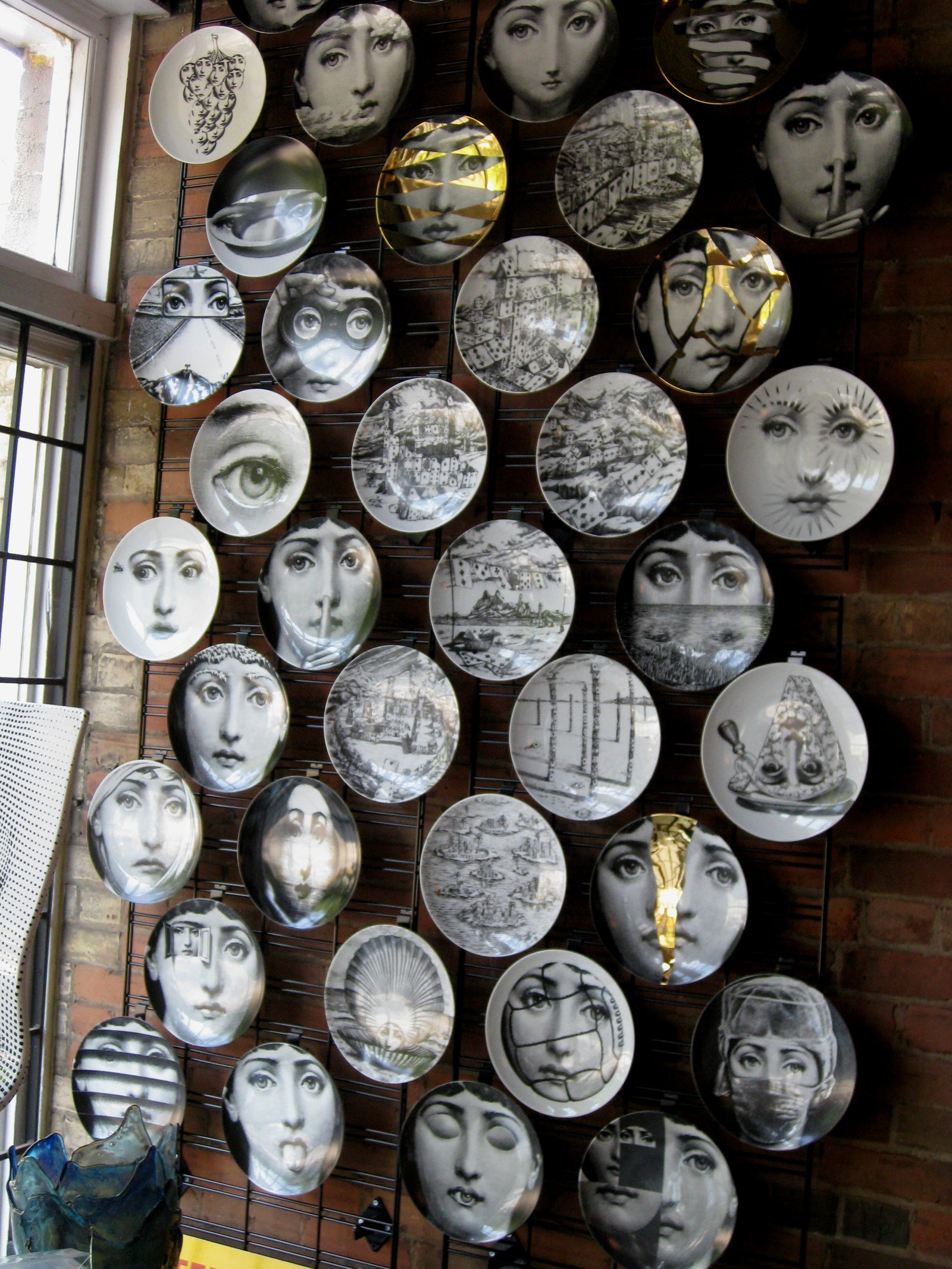 Gold Fornasetti plate Theme & Variations series no g135