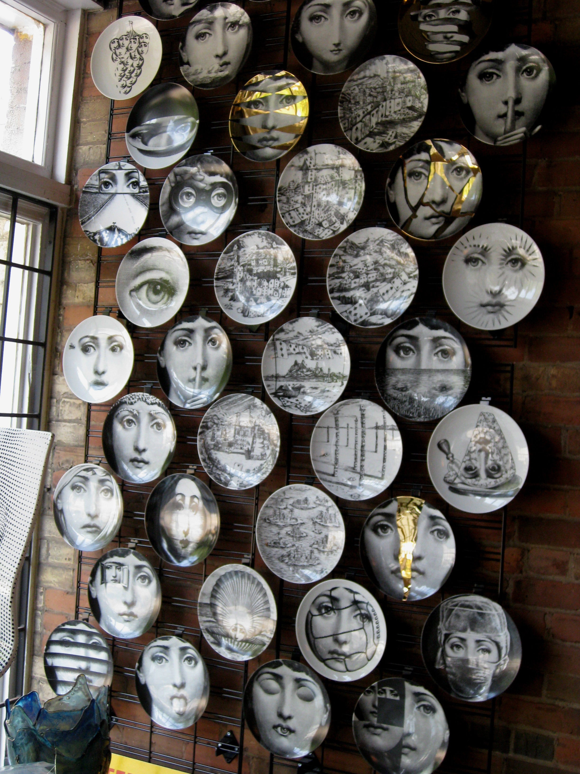 Gold Fornasetti plate Theme & Variations series no g198
