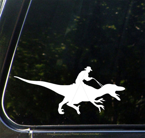 CAR - Raptor Rodeo - Dino Cowboy - Cowboy Riding a Dinosaur - Vinyl Car Decal (Color and Size Choices)