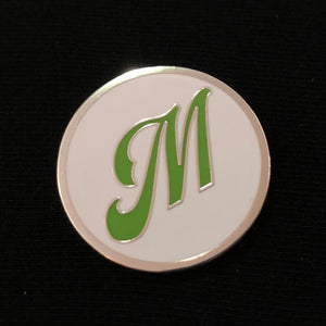 "Enamel pin - ""M"" Silver - green on white"