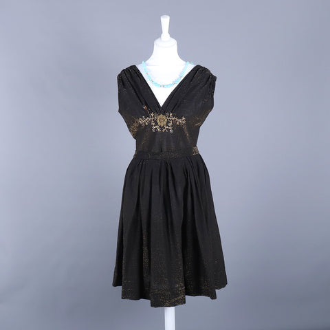 black lurex skirt and top from 1960