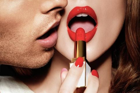 photo of lips putting on red lipstick and a man kissing her