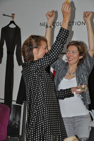 Photo of Amanda Thompson and Tarra Rosenbaum dancing at the stores party