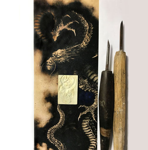 Hokusai's dragon and the hand carved tools and bone carving