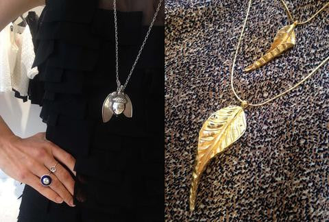 photo of a model wearing silver acorn and helicopter pod and the aurora ring on the left and on the right close up of autumn leaves and vintage silk brown fabric