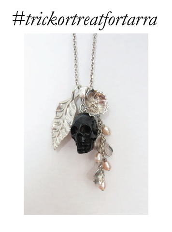 Charm necklace with a black skull, cherry blossom with pearl and petals and an autumn leaf in silver