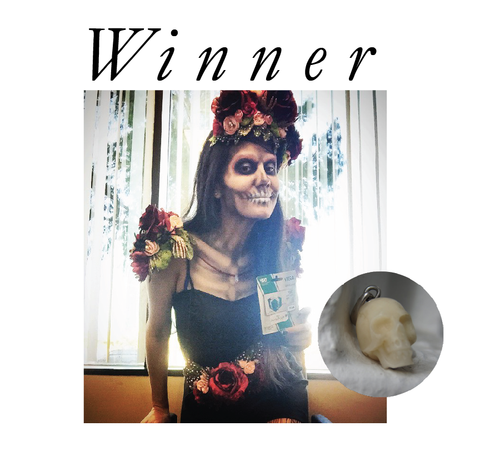 Day of the dead halloween costume with winner written at top and the skull charm