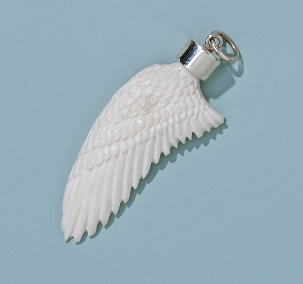 Large Hand Carved Recycled Bone Wing with Silver Cap